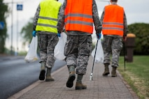 Airmen participating in Spangdahlem's Eifel Pride Program search for trash during a base cleanup at Spangdahlem Air Base, Germany, May 18, 2017. The two week program improves base appearance while also allowing Spangdahlem's first-term Airmen to in-process and become more familiar with their new duty station. (U.S. Air Force photo by Senior Airman Preston Cherry)