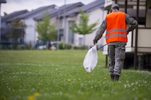 Airman Michael Agostino, 52nd Communications Squadron client systems technician, picks up trash during Spangdahlem's Eifel Pride base cleanup at Spangdahlem Air Base, Germany, May 18, 2017. The two-week program improves base appearance while also allowing Spangdahlem's first-term Airmen in-process and become familiar with their new duty station. (U.S. Air Force photo by Senior Airman Preston Cherry)