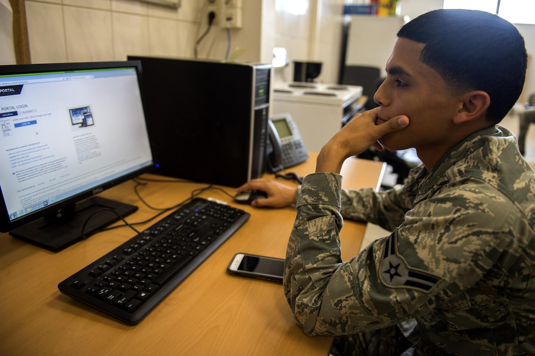 U.S. Air Force Airman 1st Class Marco Paez, 52nd Communications Squadron client systems tecnician, navigates a web page for in-processing during Spangdahlem's Eifel Pride program at Spangdahlem Air Base, Germany, May 18, 2017. During the two-week program Airmen have approximately 15 computer based trainings to complete and multiple appointments to attend in order to complete in-processing at their new duty station.