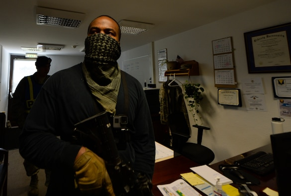 U.S. Air Force Staff Sgt. Antonio Lofton, 86th Security Forces Squadron instructor, simulates being an active shooter during an exercise at the 86th Maintenance Group on Ramstein Air Base, Germany, July 12, 2017. Multiple organizations such as command post and security forces are notified prior to the exercise to practice emergency procedures. (U.S. Air Force photo by Staff Sgt. Nesha Humes)