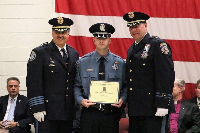 Rockland County Sheriff Louis Falco, left, and Chief of Patrol William Barbera, right, congratulate New York Army National Guard Sgt. Joseph Selchick on his completion of the Rockland County Police and Public Safety Academy in Pomona, N.Y. on June 23, 2017. Selchick is a military police soldier with the National Guard's 727th Military Police Law and Order Detachment and credits his military service for providing a foundation of experience for his success at the academy. New York Army National Guard by Col. Richard Goldenberg