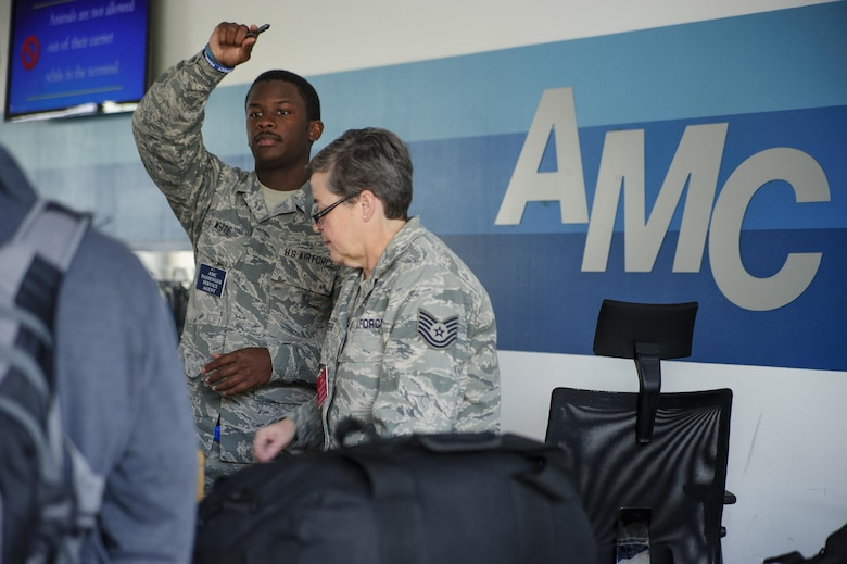 Senior Airman Marquise White and Tech. Sgt. Renee Kiger, Citizen Airmen with JB Charleston's 81st Aerial Port Squadron, perform customer service at the Ramstein Air Base Passenger Terminal, July 13, 2017.  Reservists from Charleston conducted two weeks of annual training at Ramstein AB in order to help ensure operational readiness. (U.S. Air Force photo by Senior Airman Jonathan Lane)
