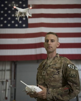 First Lieutenant Ryan Wilkerson is an Air Force Research Lab researcher attached to the 455th Expeditionary Security Forces Squadron. Wilkerson deployed to Bagram Airfield, Afghanistan, to launch a program teaching defenders how to pilot and use unmanned aircraft systems to train coalition forces to respond to the challenges UAS can present. (U.S. Air Force photo by Staff Sgt. Benjamin Gonsier)