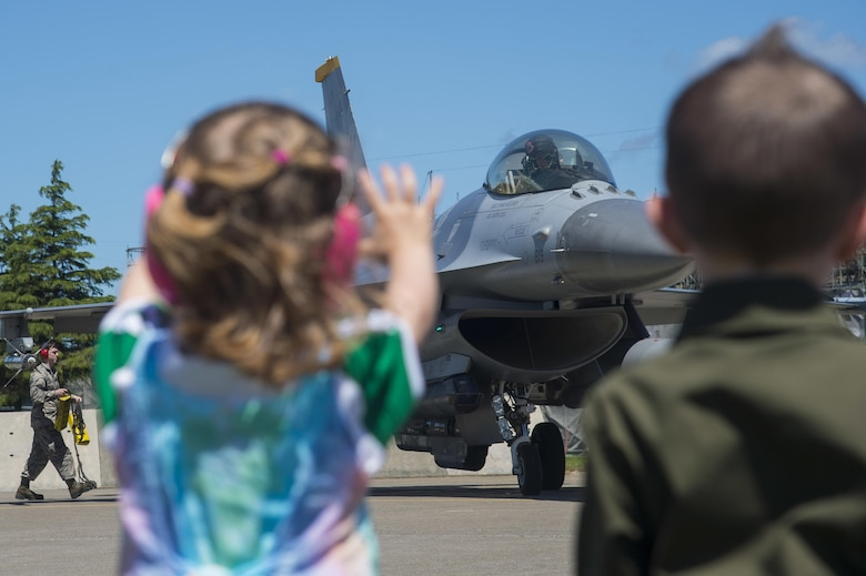 Family members of 35th Fighter Wing pilots welcome their loved ones as they return home from a temporary duty location at Misawa Air Base, Japan, June 26, 2017. The 13th Fighter Squadron and 35th Maintenance Group personnel trained with Airmen from Kunsan Air Base, South Korea, while the flightline underwent routine maintenance. During their tenure at Kunsan AB, 35th FW pilots enhanced readiness capabilities while training in unfamiliar territories with our allies within the Pacific Air Forces region. (U.S. Air Force photo/Senior Airman Deana Heitzman)