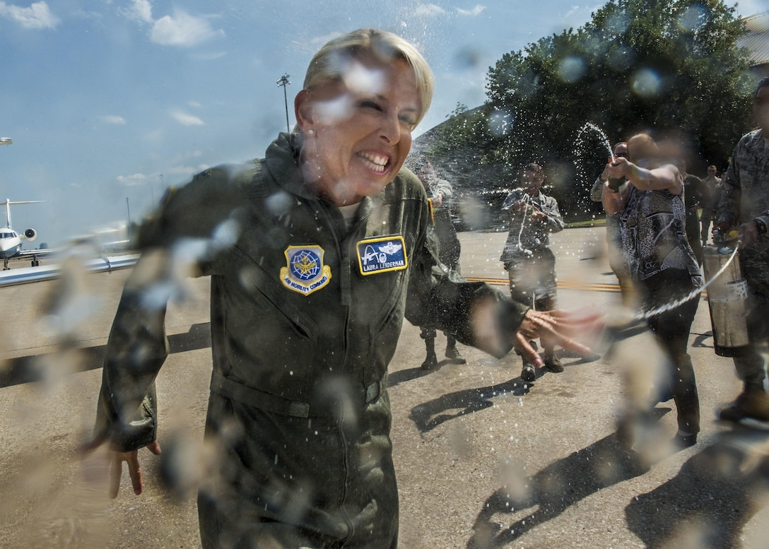 Col. Laura Lenderman, the Scott Air Force Base installation commander, celebrates her two-year command of the 375th Air Mobility Wing through a fini flight, July 10, 2017. Lenderman grew up on Scott AFB as a child, where her father served at Headquarters Military Airlift Command and inspired her to follow the same military path while creating her own legacy. As the installation celebrates its 100th year, standing as the Air Force's third oldest base, Lenderman leaves behind a legacy of caring for Airmen, strengthening community partnerships, and instilling innovation, communication, and excellence principles into the stitchings of the Scott AFB mission. (U.S. Air Force photo/ Tech. Sgt. Jodi Martinez)