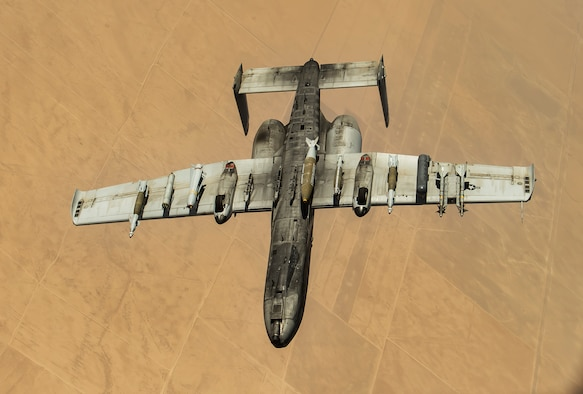 An A-10 Thunderbolt II departs after receiving fuel from a 340th Expeditionary Air Refueling Squadron KC-135 Stratotanker during a flight in support of Operation Inherent Resolve, July 6, 2017. The A-10 employs a wide variety of conventional munitions in support of OIR and the destruction of the Islamic State of Iraq and Syria. (U.S. Air Force photo/ Staff Sgt. Trevor T. McBride)