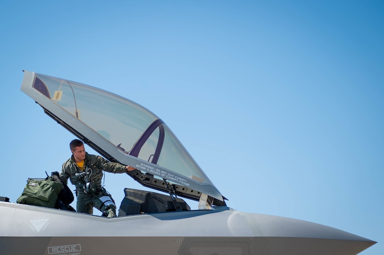 Capt. Michael Slotten, a 61st Fighter Squadron F-35 student pilot, climbs into an F-35 Lighting II at Luke Air Force Base, Ariz., July 7, 2017. Slotten dropped GBU-12 Paveway II bombs for his first time from the F-35 during training at the Barry M. Goldwater Range. (U.S. Air Force photo/Staff Sgt. Jensen Stidham)