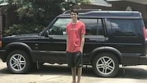 Anthony Balmer, son of Air Force Office of Special Investigations Fallen Special Agent Ryan Balmer, poses with the 2003 Land Rover his father drove prior to his death in 2007. Anthony's mother, Danielle, put the vehicle in storage until Anthony turned 18 when she gave it to him. (Courtesy photo)