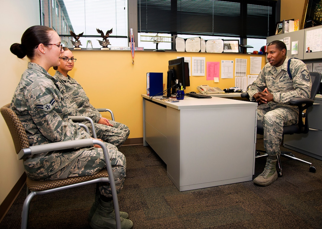 Airmen 1st Class Sierra Wahl, foreground, and Grethel Arbelo, United States Air Force School of Aerospace Medicine students, talk with Master Sgt. Michael J. Stevens, USAFSAM Military Training Flight chief, July 6, 2017, at Wright-Patterson Air Force Base, Ohio, about their hopes for their Air Force careers. Stevens, was named as one of the Air Force's 12 Outstanding Airmen of the Year. (U.S. Air Force photo by R.J. Oriez)
