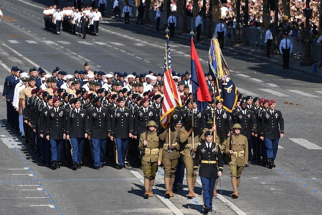 U.S. service members march in the Bastille Day military parade in Paris, July 14, 2017. Navy photo by Chief Petty Officer Michael McNabb