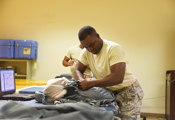 Airman Christopher Jackson, 361st Training Squadron aircrew flight equipment apprentice student packs the Back Automatic 22 style parachute at Sheppard Air Force Base, Texas. In this course students ensure that all flight and safety equipment is in perfect working order. (U.S. Air Force photo/Liz H. Colunga)