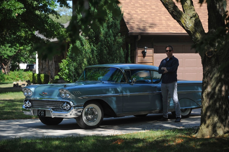 Master Sgt. Bobby McCrary, 22nd Force Support Squadron NCO in-charge of Honor Guard, poses for a photo in his car, July 13, 2017, at his home in Derby, Kan. McCrary built this car with his grandfather, a 1958 Chevy Impala. (U.S. Air Force photo/Senior Airman Jenna K. Caldwell)