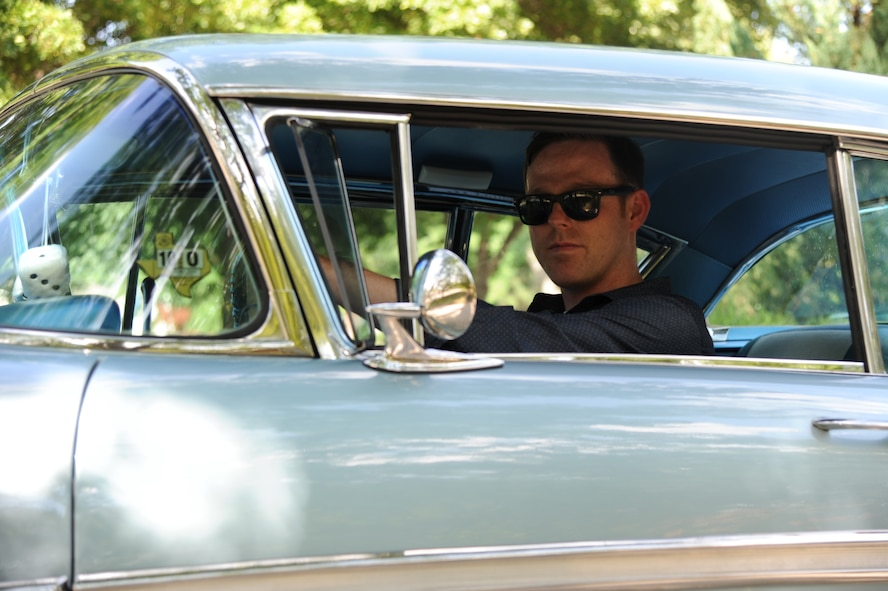 Master Sgt. Bobby McCrary, 22nd Force Support Squadron NCO in-charge of Honor Guard, poses for a photo in his 1958 Chevy Impala, July 13, 2017, at his home in Derby, Kan. McCrary grew up going to car shows and swap meets with his grandfather, who rebuilt classic cars. (U.S. Air Force photo/Senior Airman Jenna K. Caldwell)