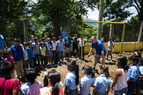 U.S. Marine Lance Cpl. Daniel M. Howard, center, basic electrician with the Logistics Combat Element, Special Purpose Marine Air-Ground Task Force - Southern Command, plays soccer with children at the Official School for Rural Community Housing in Guazacapán, Guatemala, July 7, 2017. The service members volunteered to paint the school and were invited to an opening ceremony to celebrate the renovations with students and their families. The Marines and sailors of SPMAGTF-SC are deployed to Central America to conduct security cooperation training and engineering projects with their counterparts in Belize, El Salvador, Guatemala, and Honduras. (U.S. Marine Corps photo by Cpl. Melissa Martens)