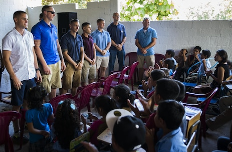 U.S. Marines and sailors with the Logistics Combat Element, Special Purpose Marine Air-Ground Task Force - Southern Command, are honored and thanked for their hard work at the Official School for Rural Community Housing in Guazacapán, Guatemala, July 7, 2017. The service members volunteered to paint the school and were invited to an opening ceremony to celebrate the renovations with students and their families. The Marines and Sailors of SPMAGTF-SC are deployed to Central America to conduct security cooperation training and engineering projects with their counterparts in Belize, El Salvador, Guatemala, and Honduras. (U.S. Marine Corps photo by Cpl. Melissa Martens)
