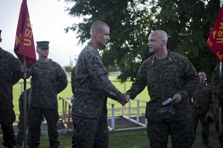 U.S. Marine Maj. Gen. David G. Bellon, the commander of U.S. Marine Corps Forces, South, recognizes U.S. Marine Sgt. Jordan D. Finch, the flight line staff noncommissioned officer in charge with the Air Combat Element, Special Purpose Marine Air-Ground Task Force - Southern Command, for his outstanding work ethic at Soto Cano Air Base, Honduras, June 29, 2017. The Marines and sailors of SPMAGTF-SC are deployed to Central America from June to November 2017 to conduct security cooperation training and engineering projects with their counterparts in Honduras, Guatemala, Belize and El Salvador.  (U.S. Marine Corps photo by Cpl. Melanie Kilcline)