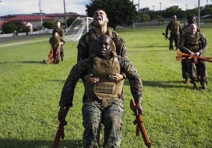 U.S. Marine Cpl. Luis D. Severino, an administrative specialist with the Command Element, Special Purpose Marine Air-Ground Task Force - Southern Command, drags U.S. Marine Staff Sgt. Christopher K. Bamfo, Mobile Training Team leader, SPMAGTF-SC, while participating in a physical training session for the Marine Corps Martial Arts Program at Soto Cano Air Base, Honduras, June 26, 2017. The purpose of MCMAP is to improve physical fitness and aid in the personal development of each Marine in a team setting. The Marines and sailors of SPMAGTF-SC are deployed to Central America for the next six months to conduct security cooperation training and engineering projects with their counterparts in Honduras, Guatemala, Belize and El Salvador. (U.S. Marine Corps photo by Cpl. Melissa Martens)