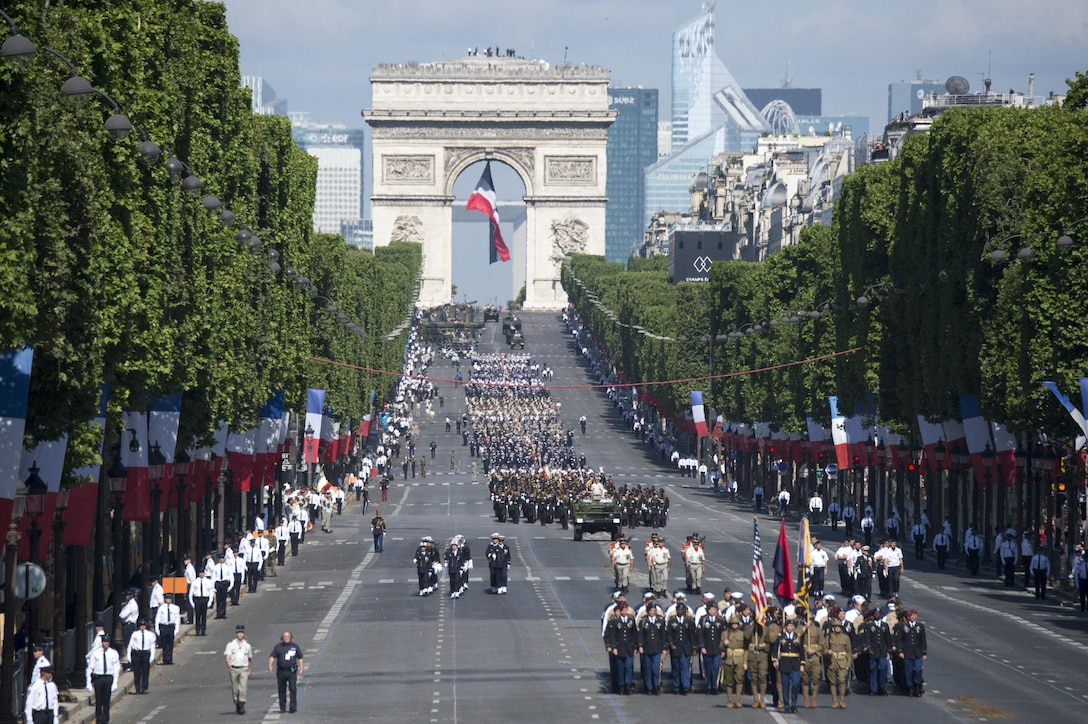 American soldiers, sailors, airmen and Marines lead the annual Bastille Day military parade down the Champs-Elysees in Paris, July 14, 2017. DoD photo by Navy Petty Officer 2nd Class Dominique Pineiro