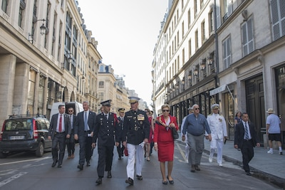 Marine Corps Gen. Joe Dunford, the chairman of the Joint Chiefs of Staff, and his wife, Ellyn, walk through the streets of Paris to attend the annual Bastille Day military parade in Paris, July 14, 2017. American troops led the parade to mark the centennial of American troops arriving in France during World War I. DoD photo by Navy Petty Officer 2nd Class Dominique Pineiro