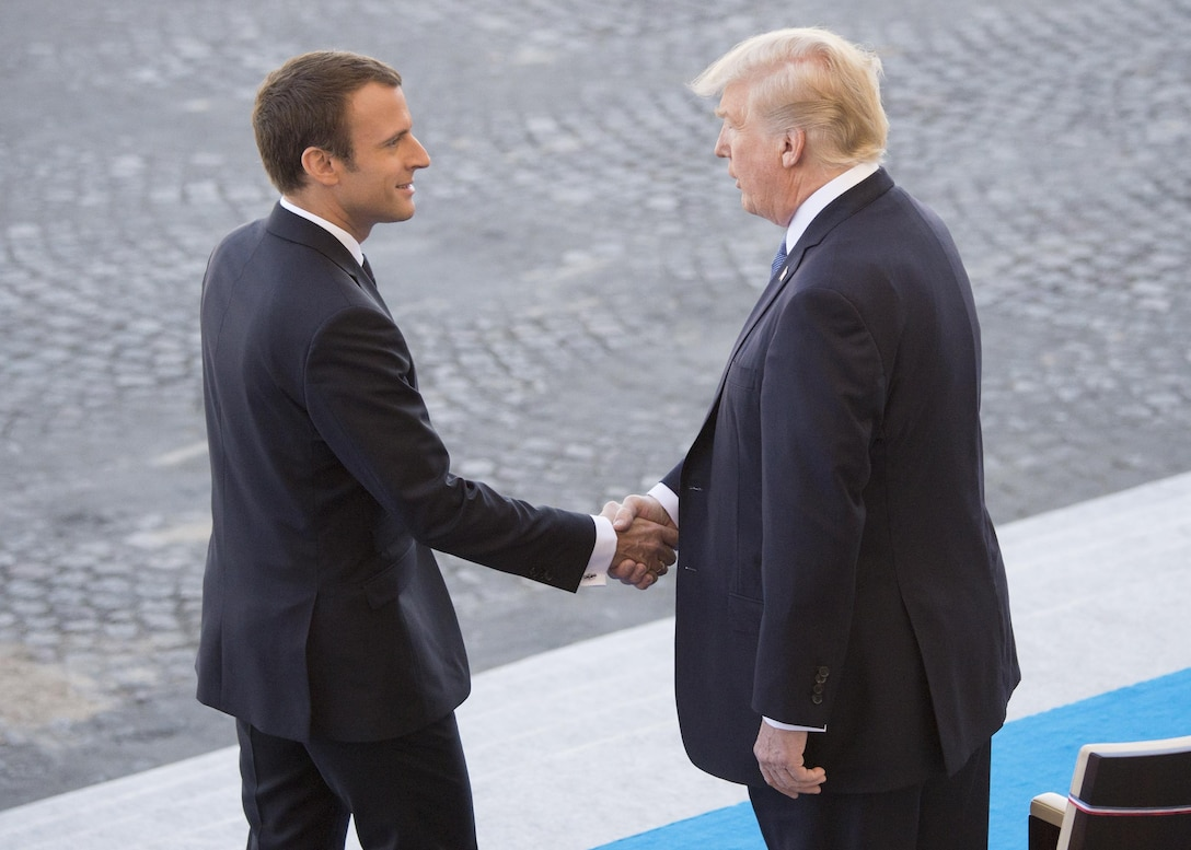 French President Emmanuel Macron welcomes President Donald J. Trump to the reviewing stand for the Bastille Day military parade in Paris, July 14, 2017. Macron and Trump recognized the continuing strength of the U.S.-France alliance from World War I to today. DoD photo by Navy Petty Officer 2nd Class Dominique Pineiro