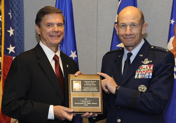 Gen. Mike Holmes, the Air Combat Command commander, is honored for analysis work with the Lt. Gen. Glenn A. Kent Leadership Award, presented by Kevin Williams, the director of Air Force Studies, Analyses and Assessments, during a July 11, 2017, ceremony at the Pentagon. The Kent Award recognizes influential leaders who have had substantive analytic responsibilities during their career and whose vision and leadership have had a significant and lasting effect on the achievements of Air Force analysis. (U.S. Air Force photo/Tech. Sgt. Robert Barnett)
