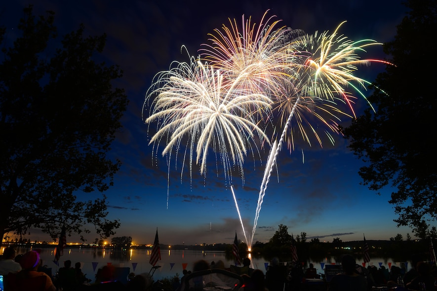 Fireworks fill the sky on July 8, 2017 at Offutt's base lake during the annual fireworks display. Several family activities took place at the celebration including face painting, treasure hunt and a performance from the Heartland of America Band. (U.S. Air Force photo by Zachary Hada)