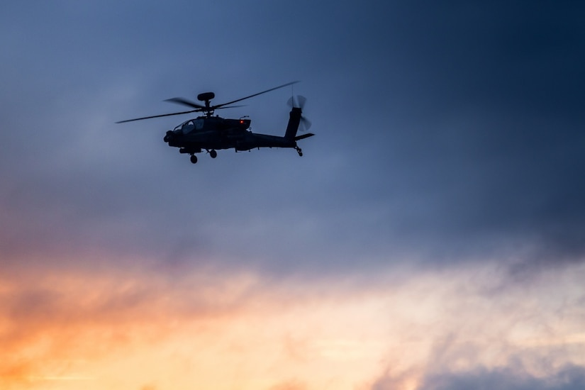 Army AH-64E Apache helicopter pilots, assigned to 16th Combat Aviation Brigade, 7th Infantry Division, fly overhead as sun's light fades over Joint Base Lewis-McChord, Wash., May 25, 2016. Training in the dark prepares aviators for the challenges they might face on real-world missions. Apaches are among the equipment the United States has sold to India as part of the two nations' growing defense relationship. Army photo by Capt. Brian Harris