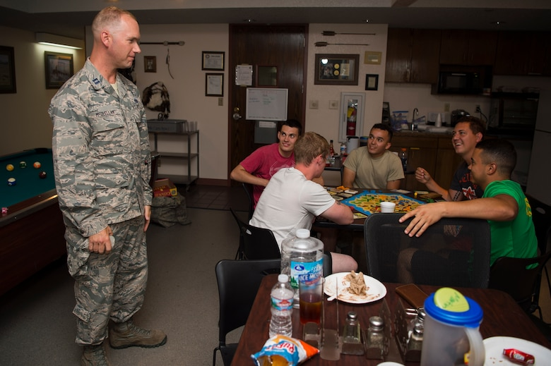 Captain Samuel McClellan, 90th Missile Wing chaplain, thanks security forces plus maintenance members, chefs and missile crew for their sacrifices and hard work during the 319th Missile Squadron code change burger burn in the 90th Missile Wing missile complex, July 12, 2017. The week-long code change sometimes requires security forces members and maintainers to stay out for days at a time to ensure they accomplish their mission. (U.S. Air Force photo by Staff Sgt. Christopher Ruano)