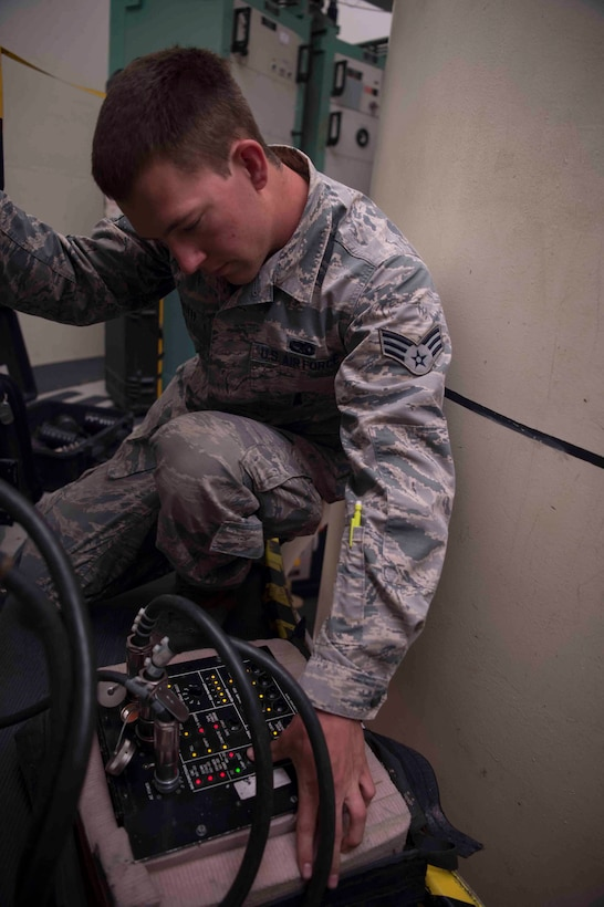 Senior Airman Logan Hershberger, 90th Missile Maintenance Squadron electromechanical team chief, hooks up a controller monitor to launch facility equipment preparing for code change operations in the 90th Missile Wing missile complex, June 20, 2017. The cryptographic codes are changed at least once a year, and the process can take up to two weeks. Code change ensures the safety, security and effectiveness of America's ICBM arsenal, which is the bedrock of nuclear deterrence. (U.S. Air Force photo by Staff Sgt. Christopher Ruano)