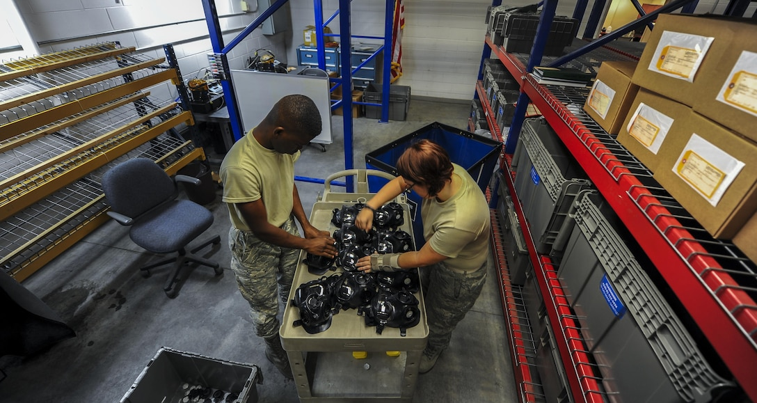 Airman 1st Class Terrence Grandberry, left, and Senior Airman Jordan Parker, materiel management journeymen with the 1st Special Operations Logistics Readiness Squadron, prepare gas masks for cleaning at Hurlburt Field, Fla., July 10, 2017. All external parts are removed from the gas masks prior to cleaning to make sure each internal component is properly cleaned. (U.S. Air Force photo by Airman 1st Class Isaac O. Guest IV)