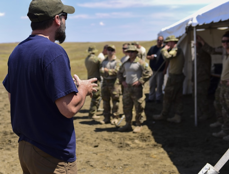 An FBI Special Agent Bomb Technician instructs a group of 28th Civil Engineer Squadron Explosive Ordinance Disposal Airmen and members of various law enforcement agencies during a National Improvised Explosive Familiarization course at Ellsworth Air Force Base, S.D., July 12, 2017. The three-day, FBI-led, joint exercise taught EOD Airmen, along with other law enforcement agencies, how to create and recognize homemade explosives. (U.S. Air Force photo by Airman 1st Class Randahl J. Jenson)