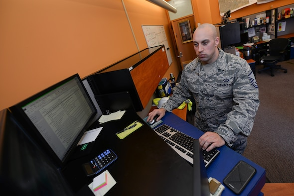 Master Sgt. Joshua Malyemezian, former 55th Contracting Squadron unit deployment manager, works on his computer Feb. 22 at Offutt Air Force Base, Nebraska. Malyemezian recently moved to the 6th Contracting Squadron, MacDill AFB, Florida, where he is the Section Chief of the Performance Management Flight. (U.S. Air Force photo by Zach Hada)