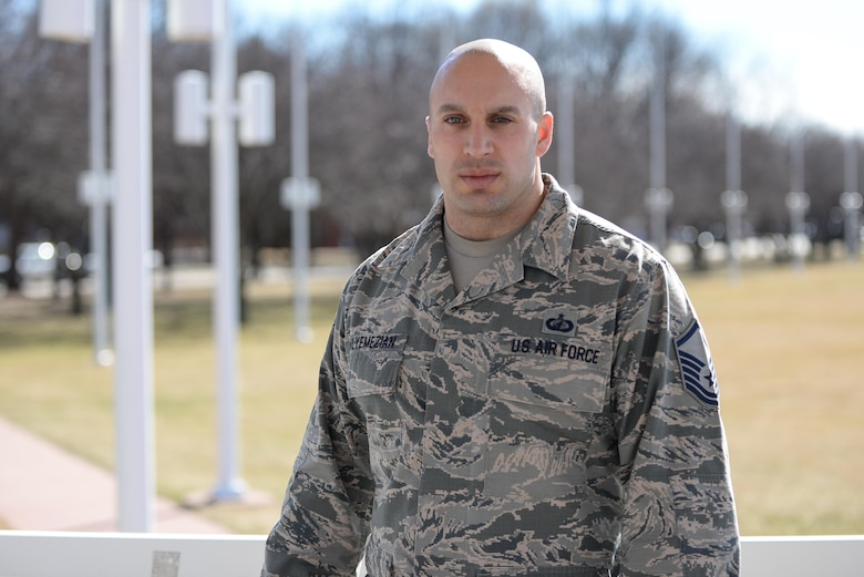 Master Sgt. Joshua Malyemezian, former 55th Contracting Squadron unit deployment manager, stand for a photo Feb. 22 at the historic parade grounds on Offutt Air Force Base, Nebraska. Malyemezian recently moved to the 6th Contracting Squadron, MacDill AFB, Florida, where he is the Section Chief of the Performance Management Flight. (U.S. Air Force photo by Zach Hada)