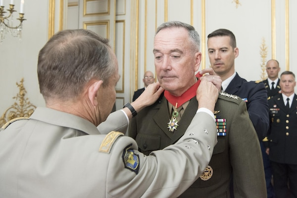 Marine Corps Gen. Joseph F. Dunford Jr., chairman of the Joint Chiefs of Staff, receives the Legion of Honor from French Gen. Pierre de Villiers, Chief of the Defense Staff in Paris on the Eve of Bastille Day July 12, 2017. This year, the U.S. will lead the parade as the country of honor in commemoration of the centennial of U.S. entry into World War 1 - as well as the long-standing partnership between France and the U.S.