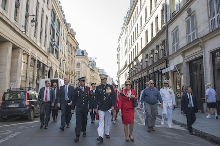 Marine Corps Gen. Joe Dunford, the chairman of the Joint Chiefs of Staff, and his wife, Ellyn, walk through the streets of Paris to attend the annual Bastille Day military parade in Paris, July 14, 2017. American troops led the parade to mark the centennial of American troops arriving in France during World War I.