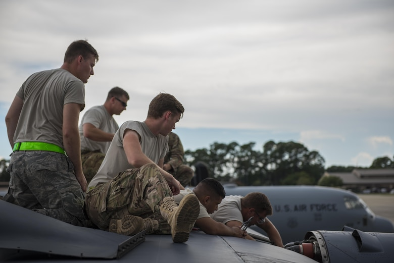 Air Commandos with the 901st Special Operations Maintenance Squadron train fellow maintainers during an engine malfunction repair on an MC-130H Combat Talon II at Hurlburt Field, Fla., July 7, 2017. Aircraft maintainers are on-call to tend to aircraft issues, ensuring mission readiness and the most capable training opportunities. (U.S. Air Force photo by Tech. Sgt. Jeffrey Curtin)