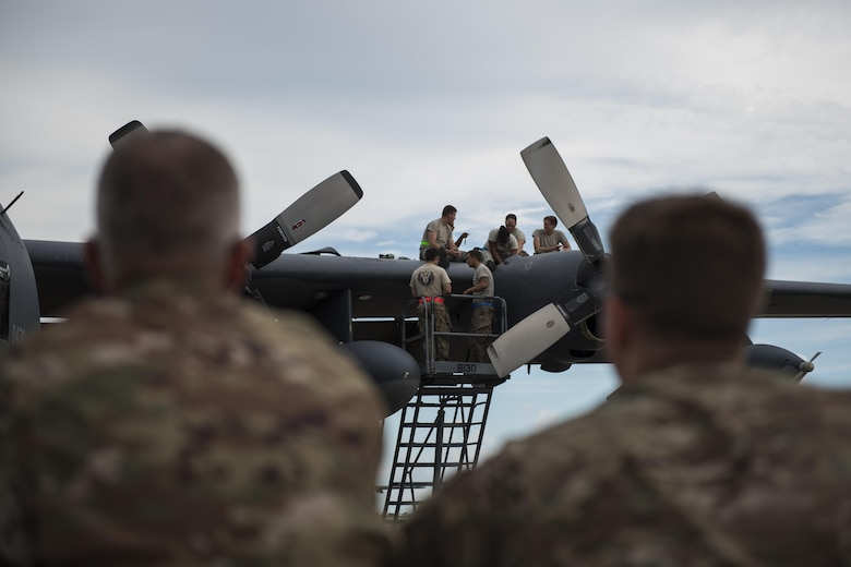 Maj. Jeff Westerman, commander of the 901st Special Operations Maintenance Squadron, and Senior Master Sgt. Carl Snider, superintendent of the 901st SOAMXS, observe their personnel as they repair an MC-130H Combat Talon II engine malfunction at Hurlburt Field, Fla., July 7, 2017. Commanders and superintendents frequently visit their Airmen on the flight line to enhance readiness and boost morale as they get after the mission in the heat, cold or rain. (U.S. Air Force photo by Tech. Sgt. Jeffrey Curtin)