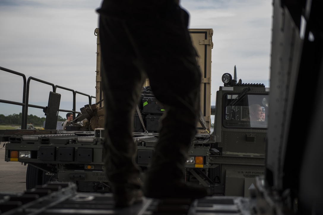 Senior Airman Adam Chudnofsky, right, a loadmaster with the 15th Special Operations Squadron, guides in a K-loader while loading equipment onto an MC-130H Combat Talon II at Hurlburt Field, Fla., July 7, 2017. Aircrew loaded an individual storage unit and other equipment necessary in preparation for Total Force Exercise 17-3 at Smyrna, Tn. TFX 17-3 is a joint forces training exercise that gives members of the 1st Special Operations Wing the opportunity to work in a joint capacity. MC-130H loadmasters make up less than one percent of the loadmaster career field and attend a specialized school for the aircraft after logging at least 500 hours on base-model C-130 aircraft. (U.S. Air Force photo by Tech. Sgt. Jeffrey Curtin)