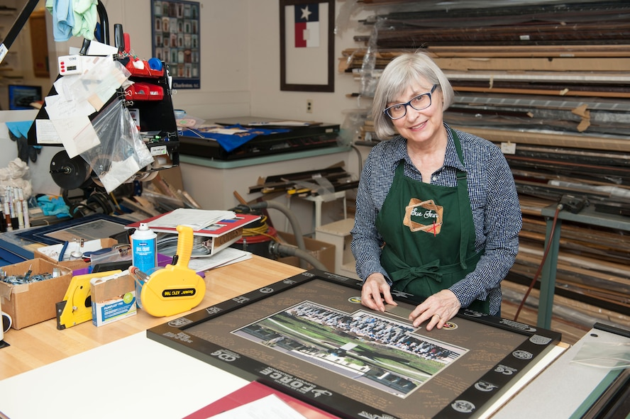 Sue Keys, Arts and Crafts Center custom picture framer, poses for a photo at Beale Air Force Base, Calif., July 13, 2017. (U.S. Air Force photo/Senior Airman Justin Parsons)