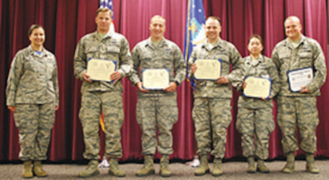 From left, Lt. Col Heather Fleishauer, Commander 752nd Operations Support Squadron, 2nd Lt. Joseph Alcorn, 116th Air Control Squadron, Portland, Ore., Capt. Michael Brode and Capt. Ryan Murphy, enroute to 726th ACS, Mountain Home AFB, Idaho, Capt. Cecilia Nguyen, 607th ACS, Luke AFB, Ariz., Capt. Nicolas Kuczera, enroute to the 607 ACS (auditing the course). The 752nd OSS celebrates the graduation of class 17-02 who have successfully completed two months of rigorous training,  finishing 42 hours of classroom academics and completing 104 hours of hands-on positional training. During their training, students were taught to employ the latest Tactical Air Operations Module AN/TYQ-23A. They are prepared for the challenging responsibilities as control and reporting center air battle managers.