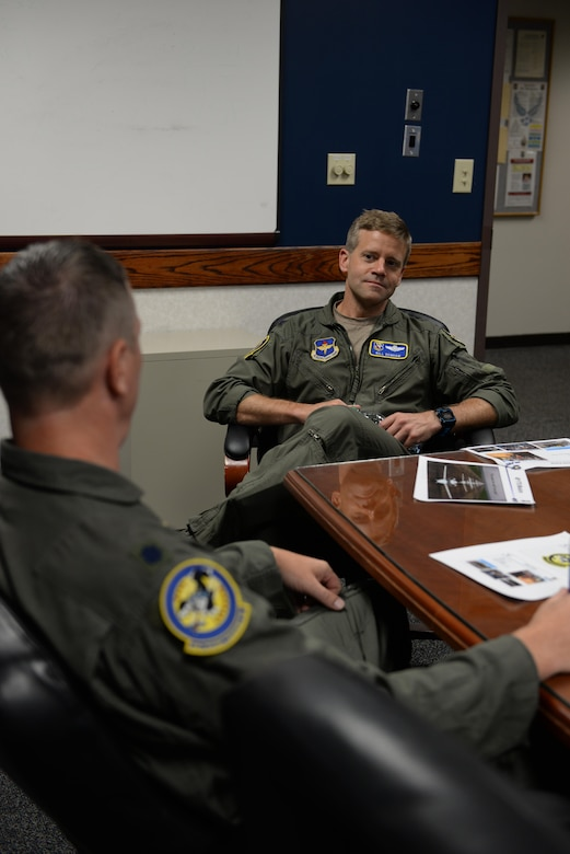 Col. William Denham, 14th Flying Training Wing Vice Commander, and Lt. Col. Alan Hietpas, 48th Flying Training Squadron Director of Operations, discuss the squadrons capabilities during the 14th Operations Group Immersion July 11, 2017, on Columbus Air Force Base, Mississippi. The 48th FTS teaches students about flying heavy aircraft and more with an emphasis on crew resource management.