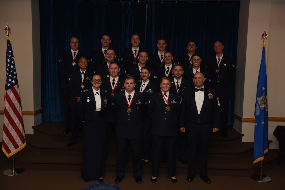 Col. Stacy Huser, 90th Missile Wing commander and Chief Master Sgt. Jeffery Steagall, 90th MW command chief, pose with the graduating Airman Leadership School Class 17-F students at F.E. Warren Air Force Base, Wyo., July 12, 2017. Enlisted Airmen must complete the rigorous professional military education course to become supervisors of other Airmen. (U.S. Air Force photo by Airman 1st Class Breanna Carter)