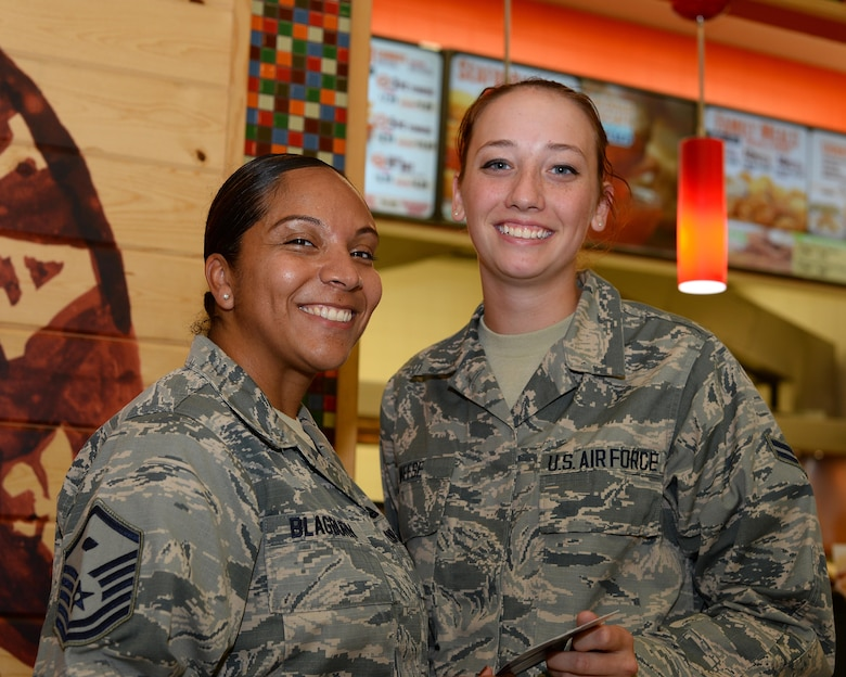 U.S. Air Force Master Sgt. Danette Blagburn, 355th Medical Group first sergeant, presents a gift card for the base exchange to Airman 1st Class Lindsey Weese, 355th Logistics Readiness Squadron material management specialist, at Davis-Monthan Air Force Base, Ariz., July 13, 2017. Weese received the gift card as part of the First Sergeant Council's random acts of kindness event. (U.S. Air Force photo by Airman 1st Class Michael X. Beyer)