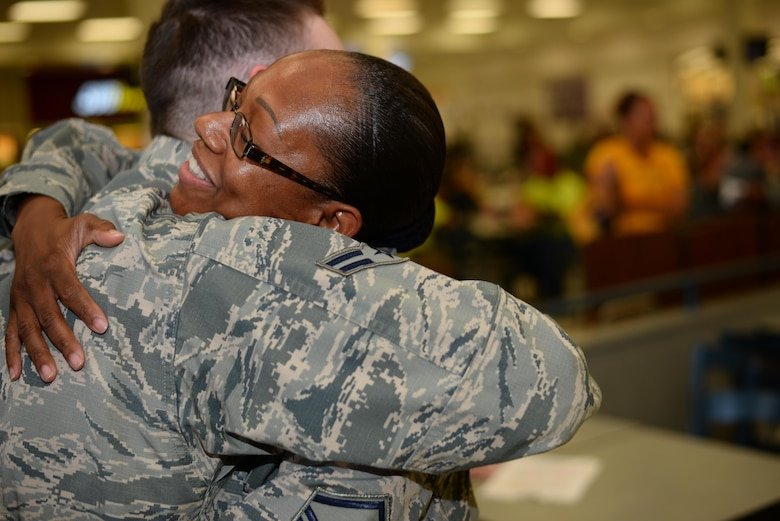 U.S. Air Force Airman 1st Class Brandon Beaudoin, 355th Medical Support Squadron personnel specialist, hugs Master Sgt. Khadijah Peterson-Carvalho, 355th Civil Engineer first sergeant, after receiving a gift card from her during the random acts of kindness event, at Davis-Monthan Air Force Base, Ariz., July 13, 2017. This was Peterson-Carvalho's first time participating in the quarterly event that showcases one of the many ways first sergeants can play an active role in the lives of Airmen. (U.S. Air Force photo by Airman 1st Class Michael X. Beyer)
