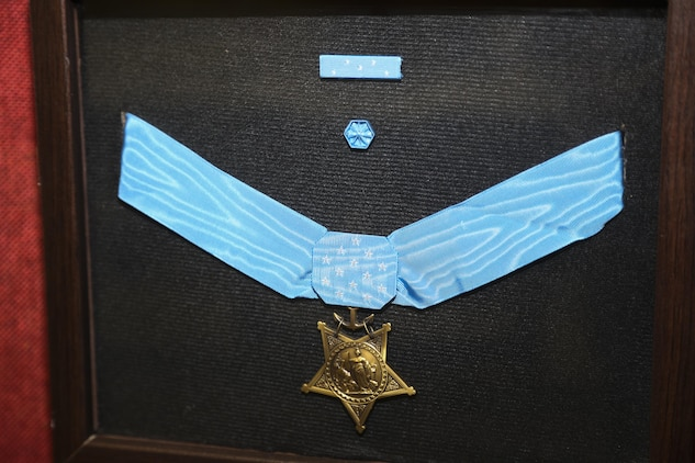 The Medal of Honor is put on display at a room dedication ceremony for a U.S. Marine Corps Medal of Honor recipient Col. Robert J. Modrzejewski ret. at the Advanced Infantry Training Battalion, School of Infantry West, Camp Pendleton, Calif;, July 14, 2017. 