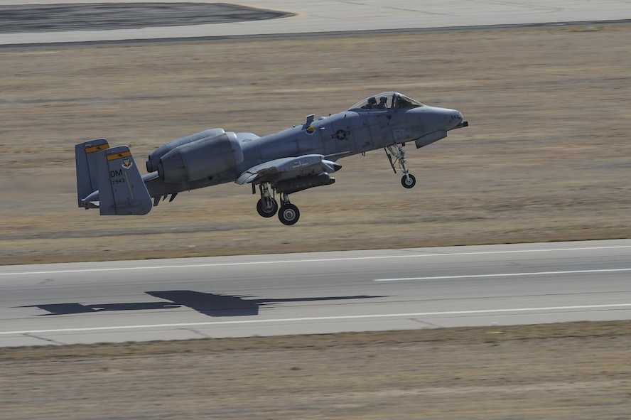 A U.S. Air Force A-10C Thunderbolt II assigned to the 357th Fighter Squadron takes off from the flight line at Davis-Monthan Air Force Base, Ariz., July 12, 2017. The aircraft can survive direct hits from armor-piercing and high explosive projectiles.(U.S. Air Force photo by Senior Airman Mya M. Crosby)