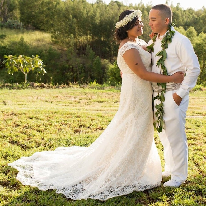 Senior Airman Kaiea Hokoana, 90th Security Forces Squadron installation patrolman, and Airman 1st Class Veulah Hokoana, 90th Force Support Squadron missile chef, pose for a wedding photo in Kula, Hawaii, Oct. 8, 2016. A week prior to the Hokoanas' wedding, they provided lifesaving assistance to a motorcyclist injured in an accident which contributed to saving the man's life. Kaiea received the Air Force Commendation Medal for his actions during an award ceremony in Cheyenne, Wyo., July 14, 2017. (U.S. Air Force courtesy photo)