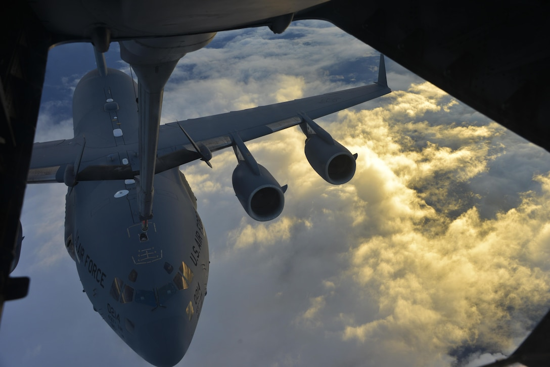 A KC-10 Extender from Travis Air Force Base, California, refuels a C-17 Globemaster III over the Pacific during Exercise Ultimate Reach July 13, 2017. During the operation, three KC-10s from Travis AFB and Joint Base McGuire-Dix-Lakehurst, New Jersey, refueled five C-17s carrying more than 300 coalition paratroopers. The C-17s went on to conduct a strategic air drop over Australia in support of Exercise Talisman Saber 2017. (U.S. Air Force photo by 2nd Lt. Sarah Johnson)