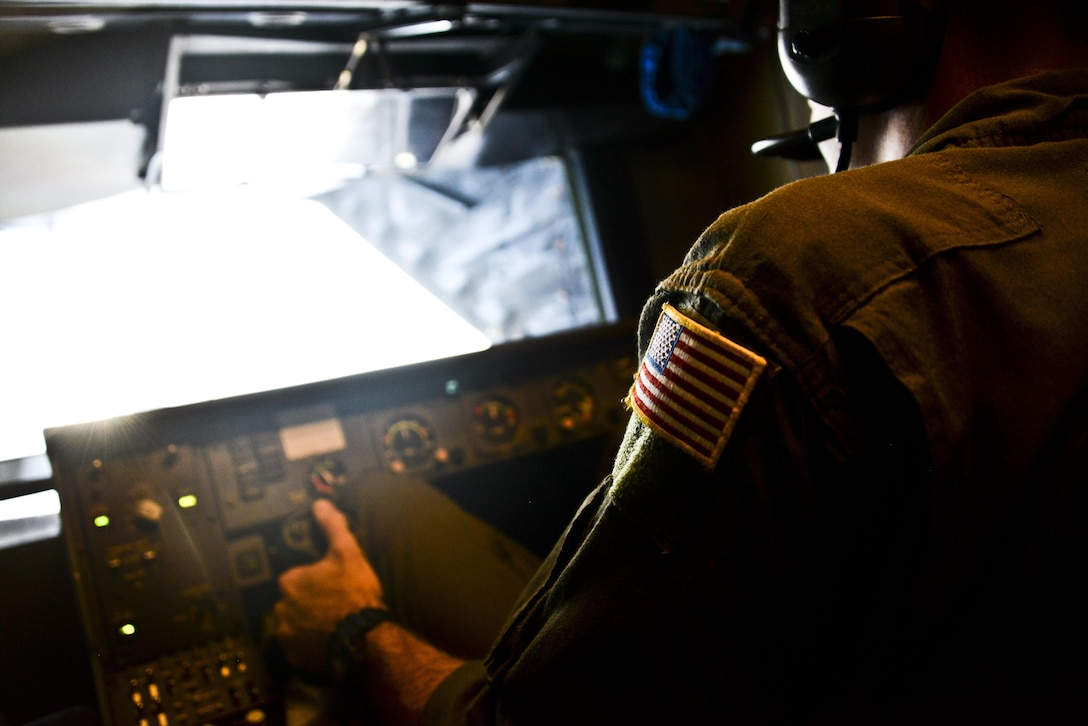 U.S. Air Force Tech. Sgt. Daniel Flenniken, 6th Air Refueling Squadron boom operator at Travis Air Force Base, California, refuels a C-17 Globemaster III over the Pacific during Exercise Ultimate Reach July 13, 2017. During the operation, three KC-10s from Travis AFB and Joint Base McGuire-Dix-Lakehurst, New Jersey, refueled five C-17s carrying more than 300 coalition paratroopers. The C-17s went on to conduct a strategic air drop over Australia in support of Exercise Talisman Saber 2017. (U.S. Air Force photo by 2nd Lt. Sarah Johnson)