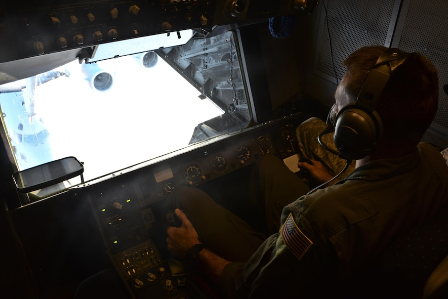 U.S. Air Force Tech. Sgt. Daniel Flenniken, 6th Air Refueling Squadron boom operator, Travis Air Force Base, California, refuels a C-17 Globemaster III over the Pacific Ocean during Exercise Ultimate Reach July 13, 2017. During the operation, three KC-10s from Travis AFB and Joint Base McGuire-Dix-Lakehurst, New Jersey, refueled five C-17s carrying more than 300 coalition paratroopers. The C-17s went on to conduct a strategic air drop over Australia in support of Exercise Talisman Saber 2017. (U.S. Air Force photo by 2nd Lt. Sarah Johnson)